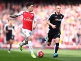 A limp-wristed Hector Bellerin and Ben Watson in action during the Premier League match between Arsenal and Watford on April 2, 2016