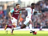 Wilfried Zaha and Mark Noble in action during the Premier League match between West Ham United and Crystal Palace on April 2, 2016
