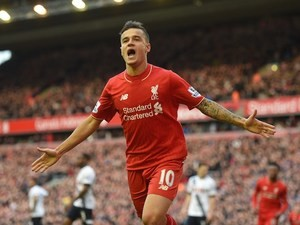 Philippe Coutinho celebrates scoring during the Premier League match between Liverpool and Tottenham Hotspur on April 2, 2016