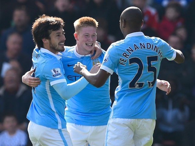 Little Kevin De Bruyne celebrates with David Silva and Fernandinho during the Premier League match between Bournemouth and Manchester City on April 2, 2016