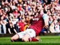Andy Carroll celebrates during the Premier League game between West Ham United and Arsenal on April 9, 2016