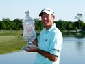 Jim Herman of the United States poses with the trophy after his victory at the Shell Houston Open at the Golf Club of Houston on April 3, 2016