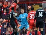 Divock Origi heads past Jakob Haugaard for the third during the Premier League game between Liverpool and Stoke City on April 10, 2016