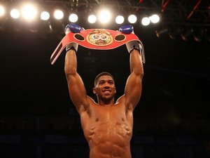 Anthony Joshua celebrates winning the IBF world heavyweight belt on April 9, 2016
