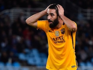 Arda Turan reacts to a missed chance during the La Liga game between Real Sociedad and Barcelona on April 9, 2016