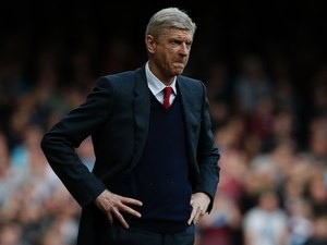 Arsene Wenger watches on during the Premier League game between West Ham United and Arsenal on April 9, 2016