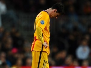 Lionel Messi reacts to Nando's goal during the Champions League quarter-final between Barcelona and Atletico Madrid on April 5, 2016