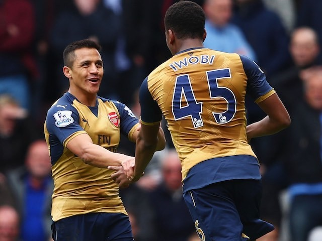 Alexis 'uncut' Sanchez celebrates with Alex Iwobi during the Premier League game between West Ham United and Arsenal on April 9, 2016