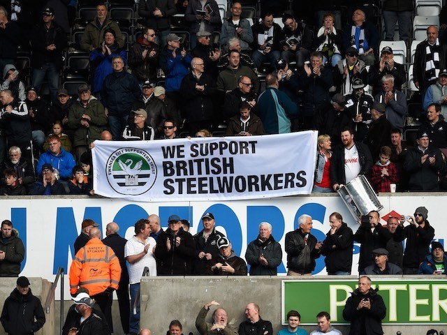 Fans make clear their views on the British steel industry during the Premier League game between Swansea City and Chelsea on April 9, 2016