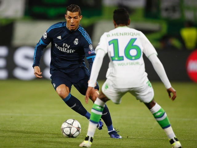 Cristiano Ronaldo takes on Bruno Henrique during the Champions League quarter-final between Wolfsburg and Real Madrid on April 6, 2016