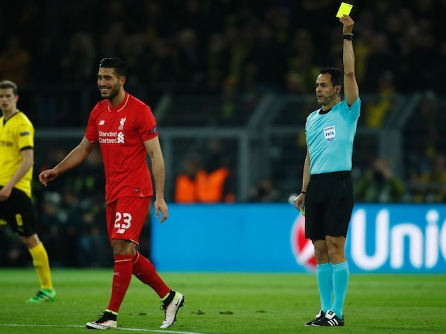 Emre Can smiles as he is shown a yellow during the Europa League quarter-final between Borussia Dortmund and Liverpool on April 7, 2016