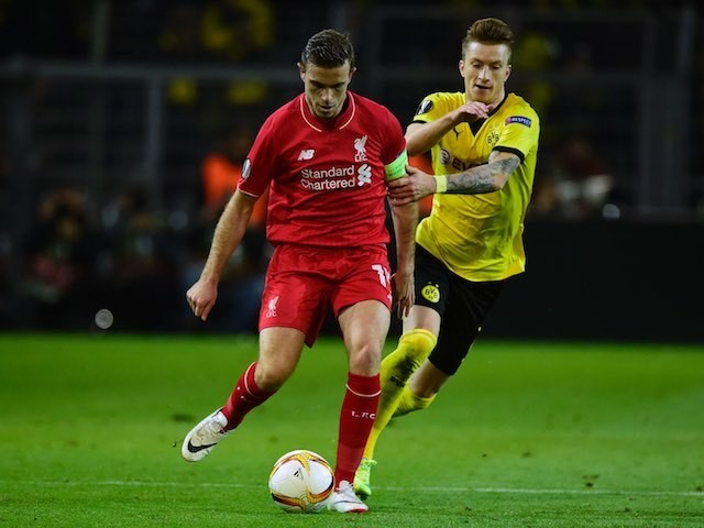 Jordan Henderson and Marco Reus in action during the Europa League quarter-final between Borussia Dortmund and Liverpool on April 7, 2016