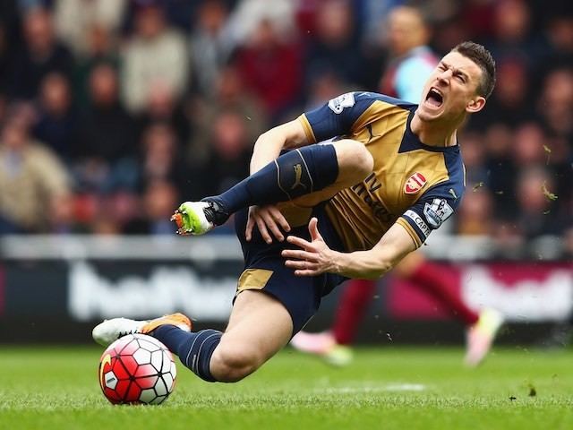 Laurent Koscielny injures his dick during the Premier League game between West Ham United and Arsenal on April 9, 2016