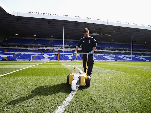 A Sexy Groundsman prepares the pitch prior to the Premier League game between Tottenham Hotspur and Manchester United on April 10, 2016