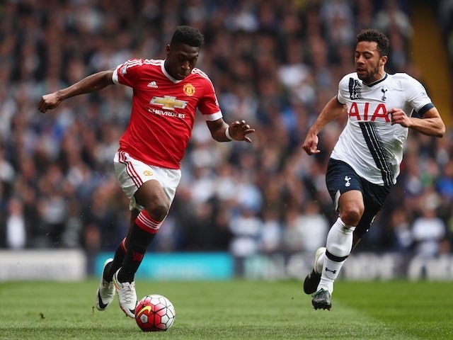 Timothy Fosu-Mensah and Mousa Dembele in action during the Premier League game between Tottenham Hotspur and Manchester United on April 10, 2016