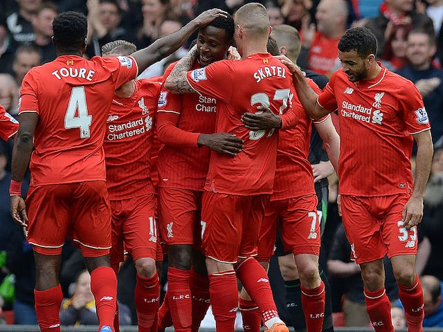 Divock Origi celebrates the fourth goal with teammates during the Premier League game between Liverpool and Stoke City on April 10, 2016