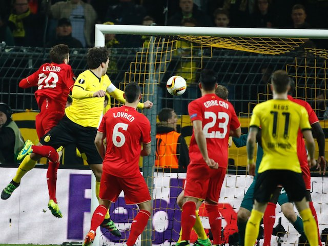 Mats Hummels scores the equaliser during the Europa League quarter-final between Borussia Dortmund and Liverpool on April 7, 2016