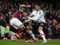 Chris Smalling and Mark Noble in action during the FA Cup replay between West Ham United and Manchester United on April 13, 2016