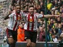 Jermain Defoe and Fabio Borini celebrate their second during the Premier League game between Norwich City and Sunderland on April 16, 2016