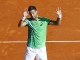 Jiri Vesely celebrates defeating Novak Djokovic at the Monte Carlo Masters on April 13, 2016