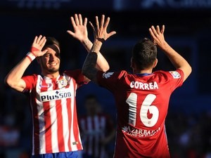 Angel Correa celebrates with Saul Niguez during the La Liga game between Atletico Madrid and Brentford on April 17, 2016