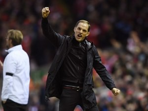 Thomas Tuchel celebrates during the Europa League quarter-final between Liverpool and Borussia Dortmund on April 14, 2016