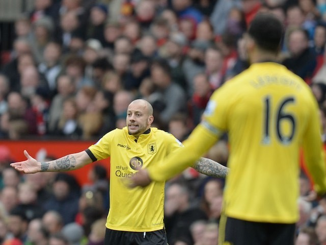 Alan Hutton shrugs during the Premier League game between Manchester United and Aston Villa on April 16, 2016