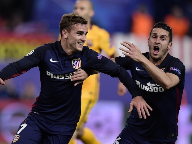 Antoine Griezmann celebrates after putting Atletico Madrid 2-0 in front against Barcelona in their Champions League quarter-final second leg on April 13, 2016