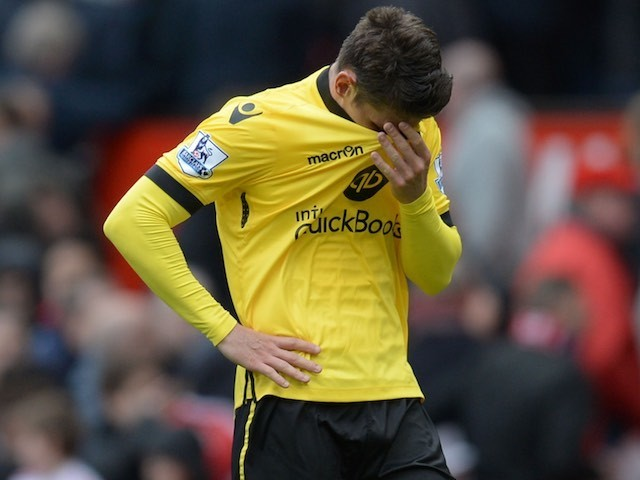 Ashley Westwood wipes away tears after the Premier League game between Manchester United and Aston Villa on April 16, 2016