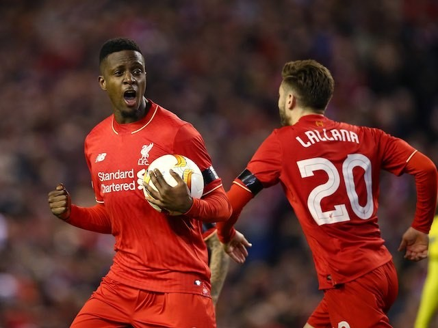 Divock Origi celebrates scoring with Adam Lallana during the Europa League quarter-final between Liverpool and Borussia Dortmund on April 14, 2016