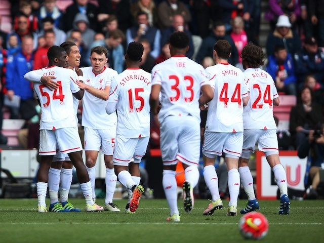 Liverpool players celebrate Roberto Firmino's goal against Bournemouth on April 17, 2016