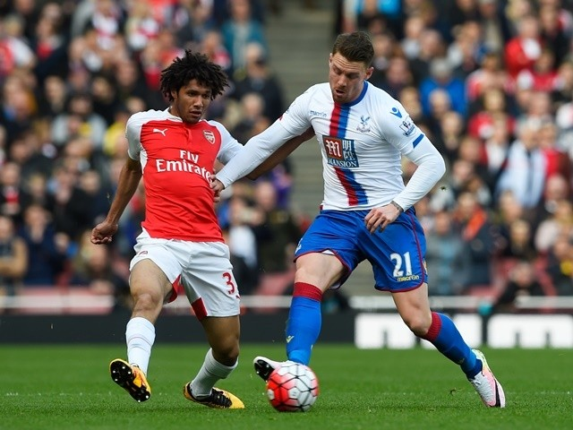 Mohamed Elneny and Connor Wickham in action during the Premier League game between Arsenal and Crystal Palace on April 17, 2016