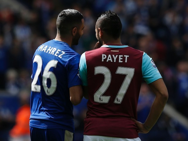 Riyad Mahrez and Dimitri Payet during the Premier League match between Leicester City and West Ham United on April 17, 2016