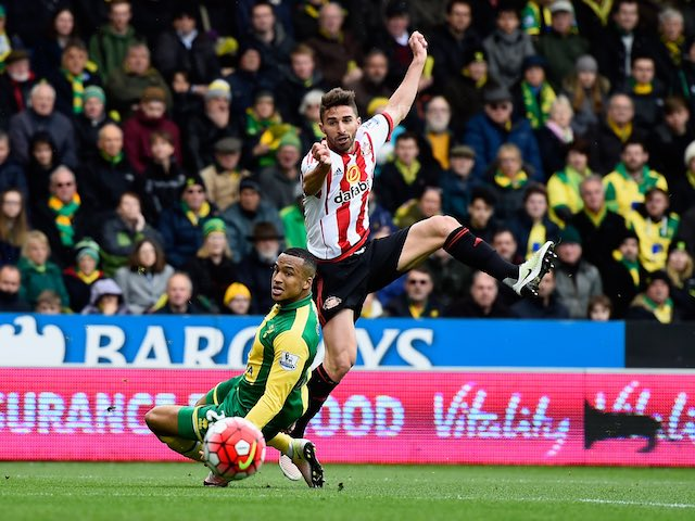 Fabio Borini and Martin Olsson in action during the Premier League game between Norwich City and Sunderland on April 16, 2016