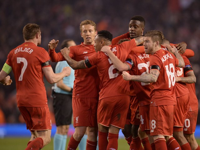 Reds players celebrate after winning the Europa League quarter-final between Liverpool and Borussia Dortmund on April 14, 2016