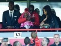 Mamadou Sakho watches on from the stands during the Premier League game between Liverpool and Newcastle United on April 23, 2016