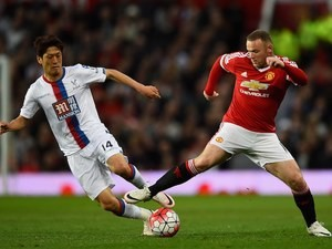 Lee Chung-yong and Wayne Rooney in action during the Premier League game between Manchester United and Crystal Palace on April 20, 2016