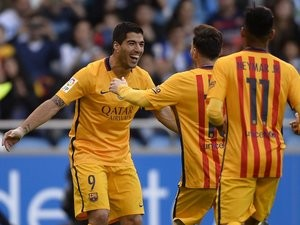 Luis Suarez celebrates his second goal during the La Liga game between Deportivo La Coruna and Barcelona on April 20, 2016