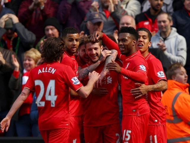Adam Lallana celebrates with teammates after scoring during the Premier League game between Liverpool and Newcastle United on April 23, 2016