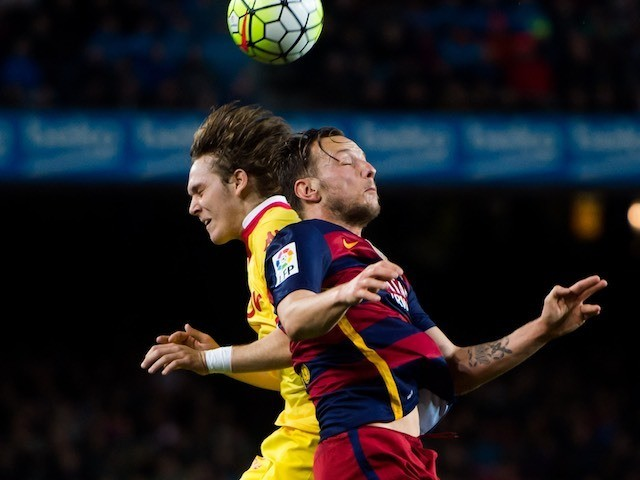 Precocious Alen Halilovic vies with Ivan Rakitic during the La Liga game between Barcelona and Sporting Gijon on April 23, 2016