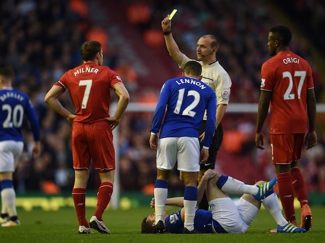 James Milner is served with a yellow during the Premier League game between Liverpool and Everton on April 20, 2016