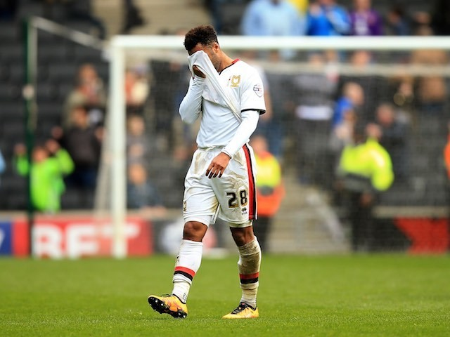 Nicky Maynard wipes his eyes as MK Dons' relegation from the Championship is confirmed on April 23, 2016