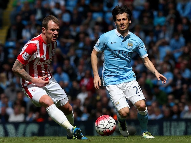 Phil Bardsley and David Silva in action during the Premier League game between Manchester City and Stoke City on April 23, 2016
