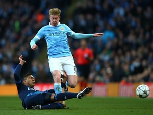 Manchester City midfielder Kevin de Bruyne is challenged by Real Madrid's Casemiro during the Champions League semi-final first leg on April 26, 2016