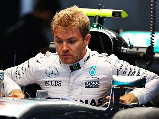 Nico Rosberg of Mercedes gets into his car in the garage during previews ahead of the Formula One Grand Prix of Russia at Sochi Autodrom on April 28, 2016