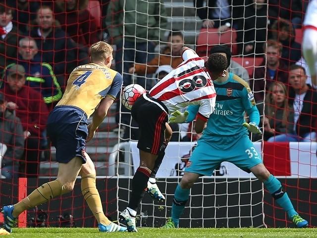 Jermain Defoe of Sunderland's shot comes off the shoulder of Per Mertesacker of Arsenal on April 24, 2016