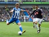 James Wilson of Brighton & Hove Albion takes a shot on goal under pressure from Marcus Olsson of Derby County on May 2, 2016