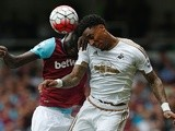 Leroy Fer and Cheikhou Kouyate vie in the air during the Premier League match between West Ham United and Swansea City on May 7, 2016