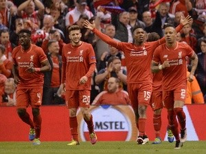 Daniel Sturridge celebrates scoring his team's second goal during the UEFA Europa League semi-final second leg between Liverpool and Villarreal at Anfield on May 5, 2016