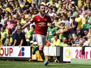 Juan Mata celebrates scoring during the Premier League game between Norwich City and Manchester United on May 7, 2016